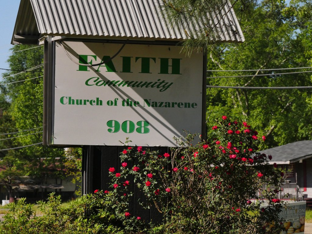 Faith Community of Hope Church sign with red roses